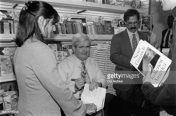 Speaker Newt Gingrich signs his book 'To Renew America' at Trover's July 9 1995