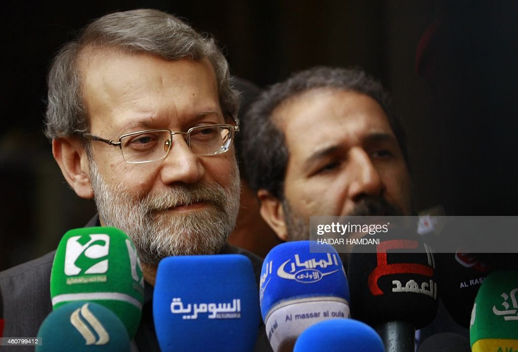 Speaker of Iran's parliament Ali Larijani gives a press conference as he visits Iraq's Shiite Muslim holy city of Najaf, about 160 kilometres south of Baghdad, on December 23, 2014. AFP PHOTO / HAIDAR HAMDANI