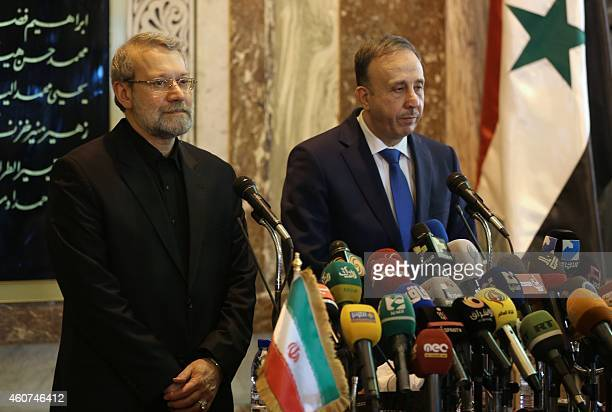 Speaker of Iran's parliament Ali Larijani holds a press conference with his Syrian counterpart Mohammad alLahham on December 21 during an official...