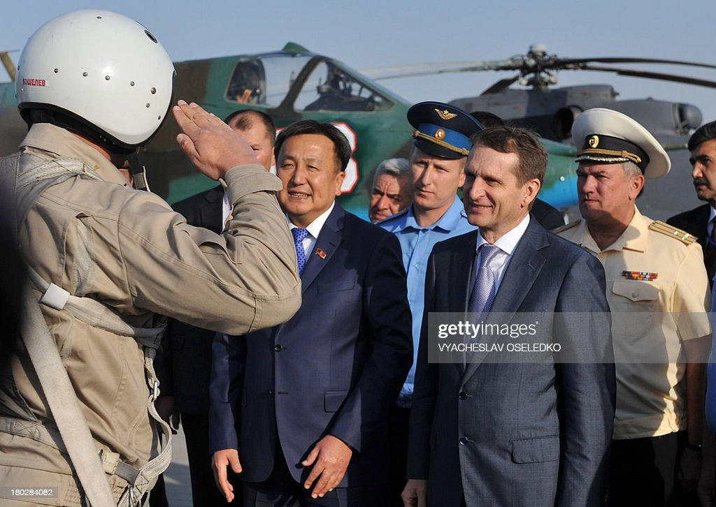 Speaker of Kyrgyzstan's Parliament Asylbek Geenbekov (2nd L) and his Russian counterpart Sergey Naryshkyn (2nd R) inspect the Russian military base in Kant some 20km outside Bishkek, on October 8, 2013.