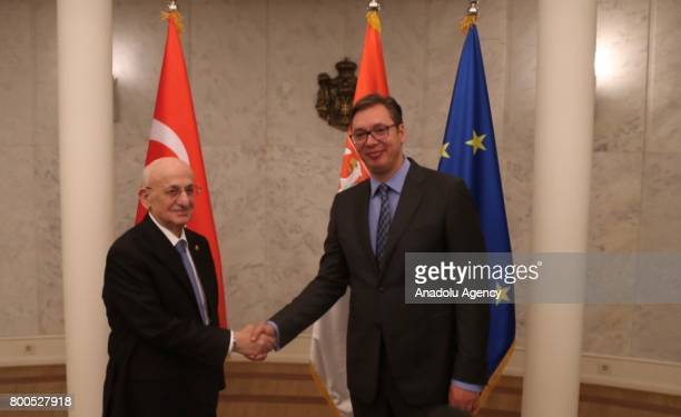 Speaker of the Grand National Assembly Ismail Kahraman shakes hands with Serbia's new President Aleksandar Vucic during their meeting on Palace of...