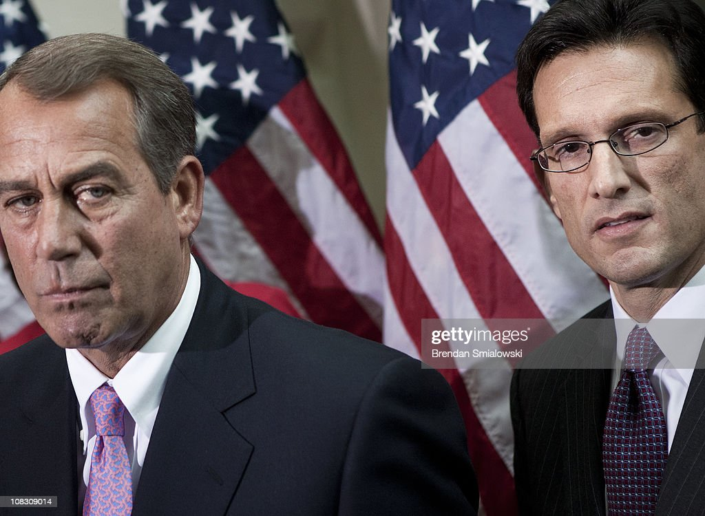 Speaker of the House John Boehner and Majority Leader Eric Cantor listen to questions from reporters after a meeting of House Republicans January 25...