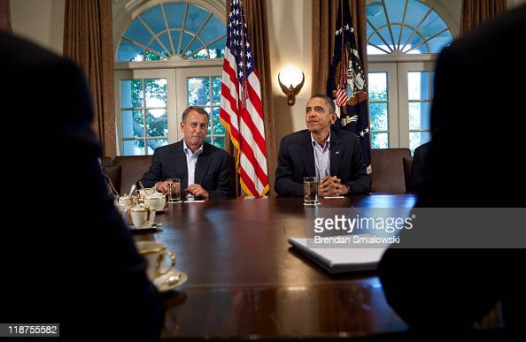 Speaker of the House John Boehner and President Barack Obama wait before a meeting in the Cabinet Room of the White House July 10 2011 in Washington...