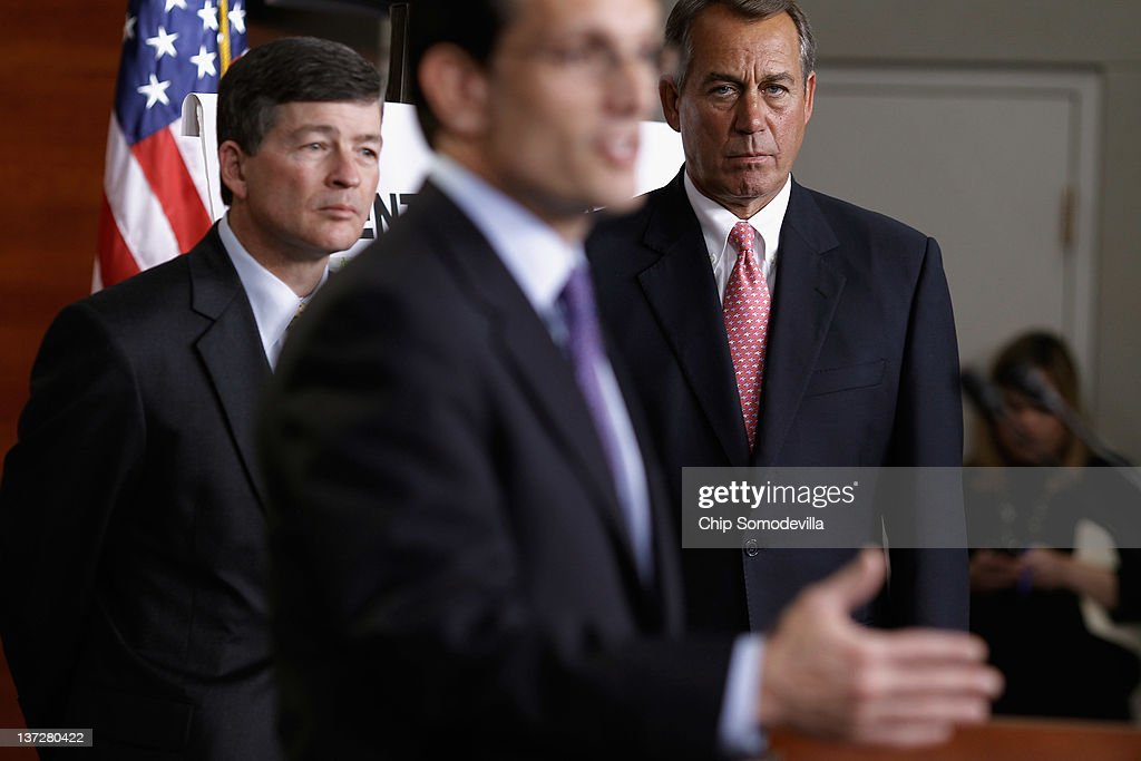 Speaker of the House John Boehner and Rep Jeb Hensarling listen to House Majority Leader Eric Cantor during a press briefingat the US Capitol January...