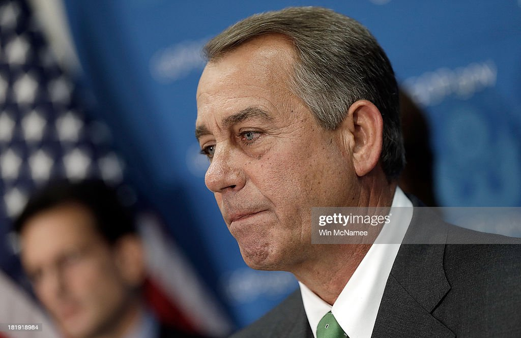 U.S. Speaker of the House <a gi-track='captionPersonalityLinkClicked' href=/galleries/search?phrase=John+Boehner&family=editorial&specificpeople=274752 ng-click='$event.stopPropagation()'>John Boehner</a> answers questions at a press conference at the U.S. Capitol September 26, 2013 in Washington, DC. Boehner signaled that he is urging Republican colleagues to remain flexible in negotiations to avert a governmental shutdown when federal funding runs out next week. Also pictured is House Majority Leader Eric Cantor (R-VA) (L).