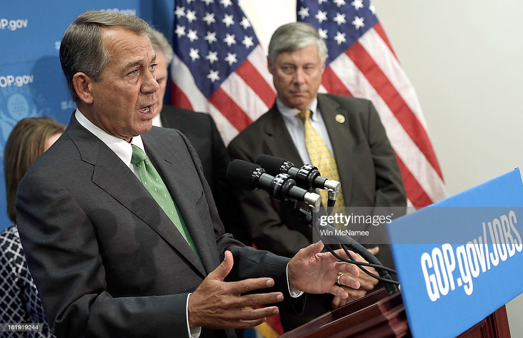 U.S. Speaker of the House <a gi-track='captionPersonalityLinkClicked' href=/galleries/search?phrase=John+Boehner&family=editorial&specificpeople=274752 ng-click='$event.stopPropagation()'>John Boehner</a> (L) (R-OH) answers questions at a press conference at the U.S. Capitol September 26, 2013 in Washington, DC. Boehner signaled that he is urging Republican colleagues to remain flexible in negotiations to avert a governmental shutdown when federal funding runs out next week. Also pictured is Rep. Fred Upton (R) (R-MI).
