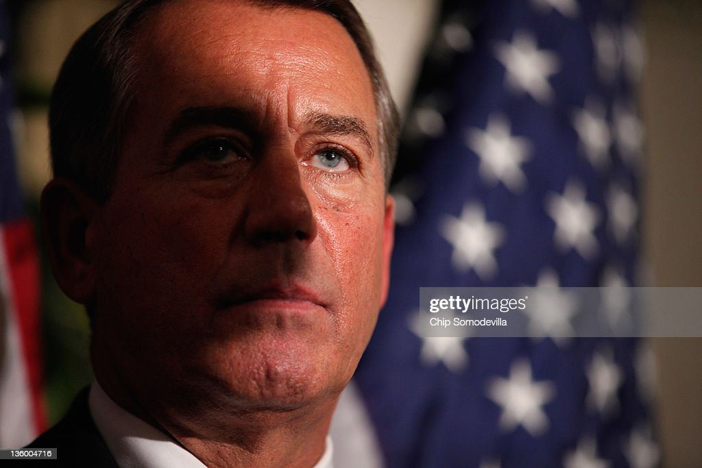 Speaker of the House <a gi-track='captionPersonalityLinkClicked' href=/galleries/search?phrase=John+Boehner&family=editorial&specificpeople=274752 ng-click='$event.stopPropagation()'>John Boehner</a> (R-OH) answers reporters' questions during a brief news conference after a House GOP caucus meeting at the U.S. Capitol December 19, 2011 in Washington, DC. Boehner said he expects the House to reject a short-term plan to extend the tax cuts for another two months that passe the Senate last week.