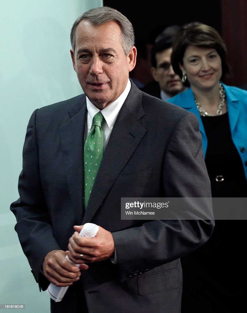 U.S. Speaker of the House <a gi-track='captionPersonalityLinkClicked' href=/galleries/search?phrase=John+Boehner&family=editorial&specificpeople=274752 ng-click='$event.stopPropagation()'>John Boehner</a> (R-OH) arrives for a press conference at the U.S. Capitol September 26, 2013 in Washington, DC. Boehner signaled that he is urging Republican colleagues to remain flexible in negotiations to avert a governmental shutdown when federal funding runs out next week. Also pictured is Rep. Cathy McMorris Rodgers (R) (R-WA).