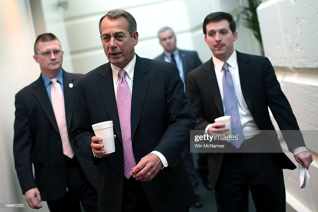 Speaker of the House <a gi-track='captionPersonalityLinkClicked' href=/galleries/search?phrase=John+Boehner&family=editorial&specificpeople=274752 ng-click='$event.stopPropagation()'>John Boehner</a> (R-OH) (2nd L) arrives for a Republican conference meeting at the U.S. Capitol on January 4, 2013 in Washington, DC. The House of Representatives is expected to vote later today on an aid package for those impacted by Hurricane Sandy.