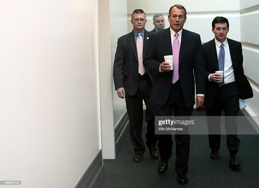 Speaker of the House <a gi-track='captionPersonalityLinkClicked' href=/galleries/search?phrase=John+Boehner&family=editorial&specificpeople=274752 ng-click='$event.stopPropagation()'>John Boehner</a> (R-OH) (2nd R) arrives for a Republican conference meeting at the U.S. Capitol on January 4, 2013 in Washington, DC. The House of Representatives is expected to vote later today on an aid package for those impacted by Hurricane Sandy.