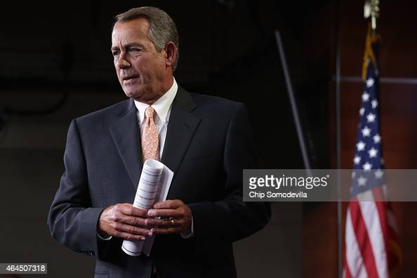 Speaker of the House John Boehner arrives for his weekly news conference at the US Capitol Visitors Center February 26 2015 in Washington DC With...