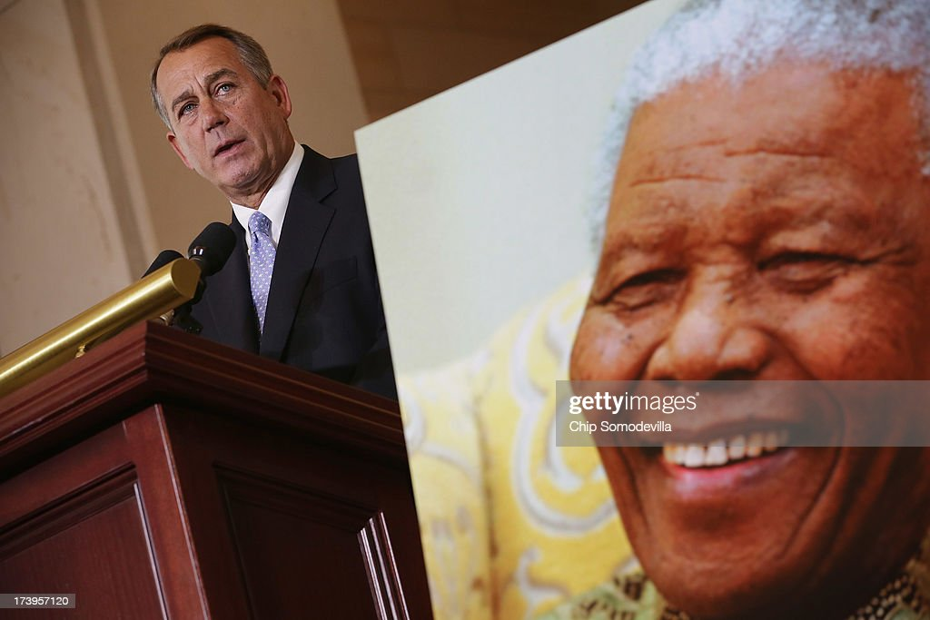 Speaker of the House <a gi-track='captionPersonalityLinkClicked' href=/galleries/search?phrase=John+Boehner&family=editorial&specificpeople=274752 ng-click='$event.stopPropagation()'>John Boehner</a> (R-OH) delivers remarks during a ceremony to celebrate the life Nobel Peace Prize laureate and former South Africa President Nelson Mandela on the occasion of his 95th birthday in the U.S. Capitol Visitor Center July 18, 2013 in Washington, DC. July 18 is Nelson Mandela Day, during which people are asked to give 67 minutes of time to charity and service in their community to honor the 67 years Mandela gave to public service. Mandela was admitted to a South African hospital June 8 where he is being treated for a recurring lung infection.