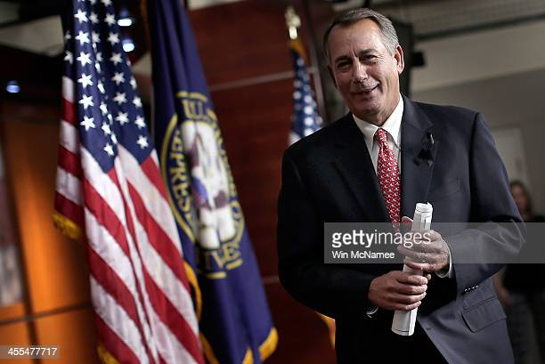 S Speaker of the House John Boehner departs a press conference December 12 2013 in Washington DC When asked during the press conference if he would...