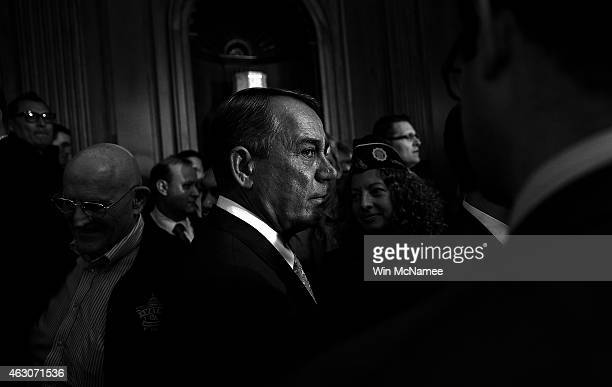 S Speaker of the House John Boehner greets military veterans after speaking at an event urging reform at the Department of Veterans Affairs at the US...