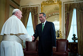 Speaker of the House John Boehner greets Pope Francis in the US Capitol building before the Pontiff speaks to a joint meeting of Congress September...