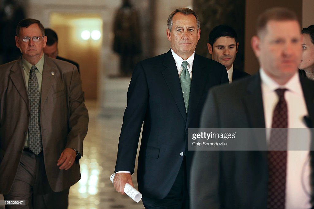 Speaker of the House <a gi-track='captionPersonalityLinkClicked' href=/galleries/search?phrase=John+Boehner&family=editorial&specificpeople=274752 ng-click='$event.stopPropagation()'>John Boehner</a> (R-OH) (C) heads to the House floor to address members on the 'fiscal cliff' negotiations with the White House and Congressional Democrats at the U.S. Capitol December 11, 2012 in Washington, DC. Boehner's office said he will announce that negotiations are making headway toward averting the automatic steep tax hikes and spending cuts set for the end of the year.