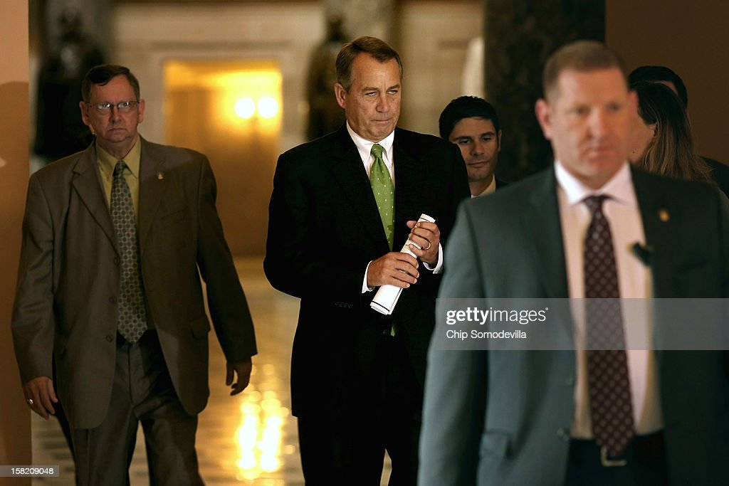 Speaker of the House <a gi-track='captionPersonalityLinkClicked' href=/galleries/search?phrase=John+Boehner&family=editorial&specificpeople=274752 ng-click='$event.stopPropagation()'>John Boehner</a> (R-OH) (2L) heads to the House floor to address members on the 'fiscal cliff' negotiations with the White House and Congressional Democrats at the U.S. Capitol December 11, 2012 in Washington, DC. Boehner's office said he will announce that negotiations are making headway toward averting the automatic steep tax hikes and spending cuts set for the end of the year.