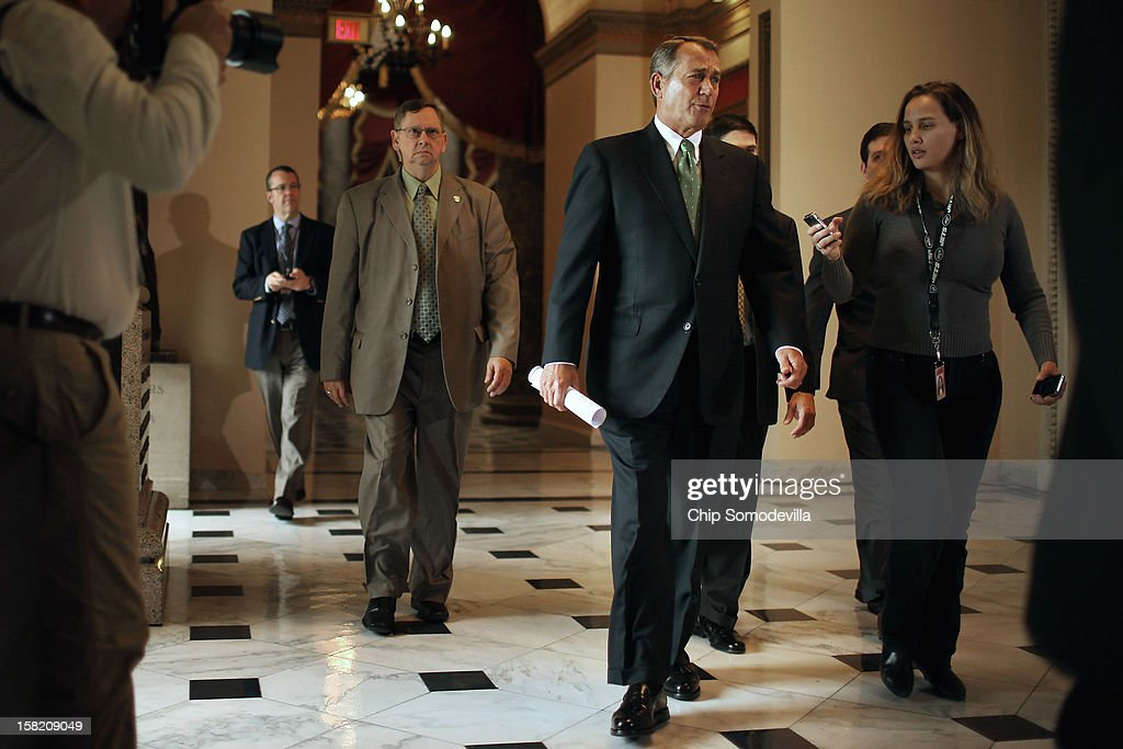 Speaker of the House John Boehner (R-OH) (C) heads to the House floor to address members on the 'fiscal cliff' negotiations with the White House and Congressional Democrats at the U.S. Capitol December 11, 2012 in Washington, DC. Boehner's office said he will announce that negotiations are making headway toward averting the automatic steep tax hikes and spending cuts set for the end of the year.