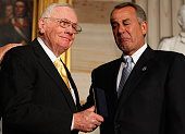 Speaker of the House John Boehner holds back tears as he presents Astronaut Neil Armstrong with the Congressional Gold Medal during a ceremony in the...