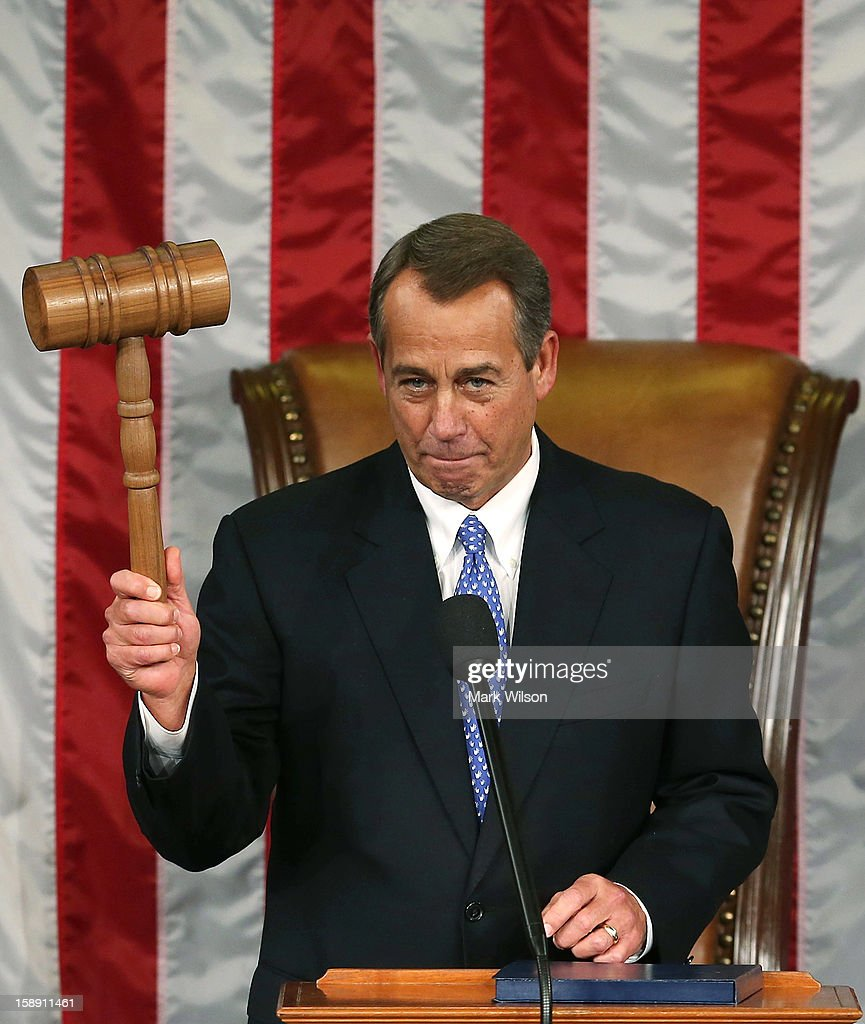 Speaker of the House <a gi-track='captionPersonalityLinkClicked' href=/galleries/search?phrase=John+Boehner&family=editorial&specificpeople=274752 ng-click='$event.stopPropagation()'>John Boehner</a> (R-OH) holds the gavel during the first session of the 113th Congress in the House Chambers January 3, 2013 in Washington, DC. House Speaker Boehner was re-elected as Speaker and presided over the swearing in of the newly elected members of the 113th Congress.