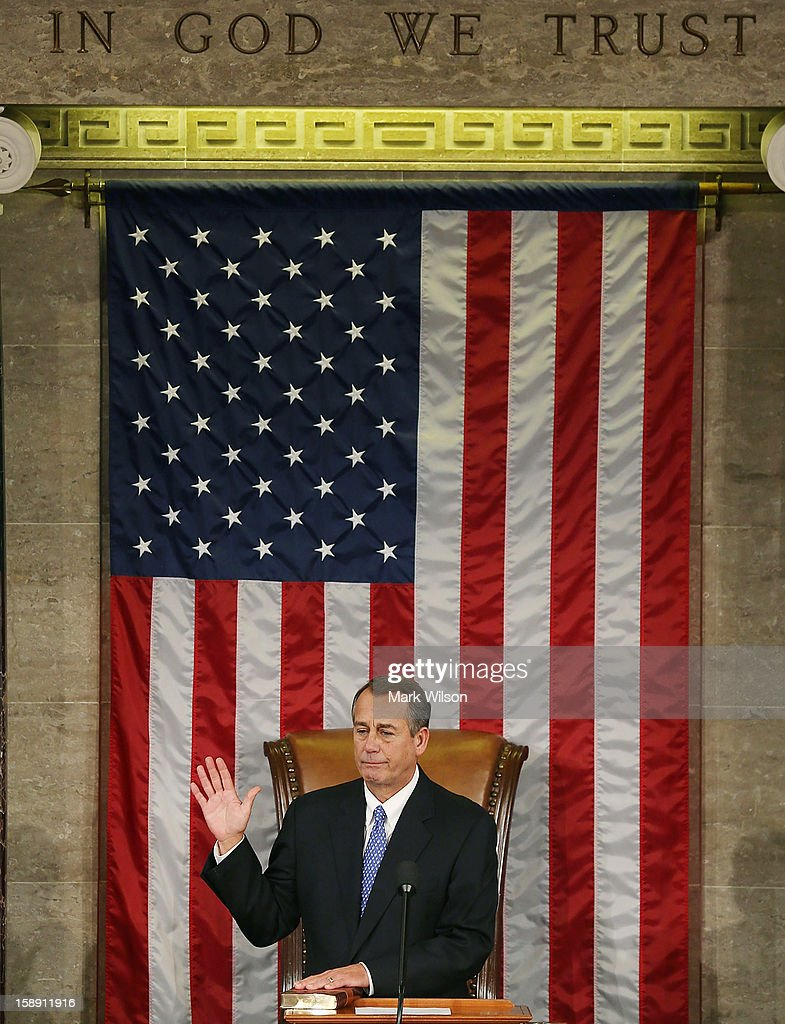 Speaker of the House <a gi-track='captionPersonalityLinkClicked' href=/galleries/search?phrase=John+Boehner&family=editorial&specificpeople=274752 ng-click='$event.stopPropagation()'>John Boehner</a> (R-OH) is sworn in during the first session of the 113th Congress in the House Chambers January 3, 2013 in Washington, DC. House Speaker Boehner was re-elected as Speaker and presided over the swearing in of the newly elected members of the 113th Congress.