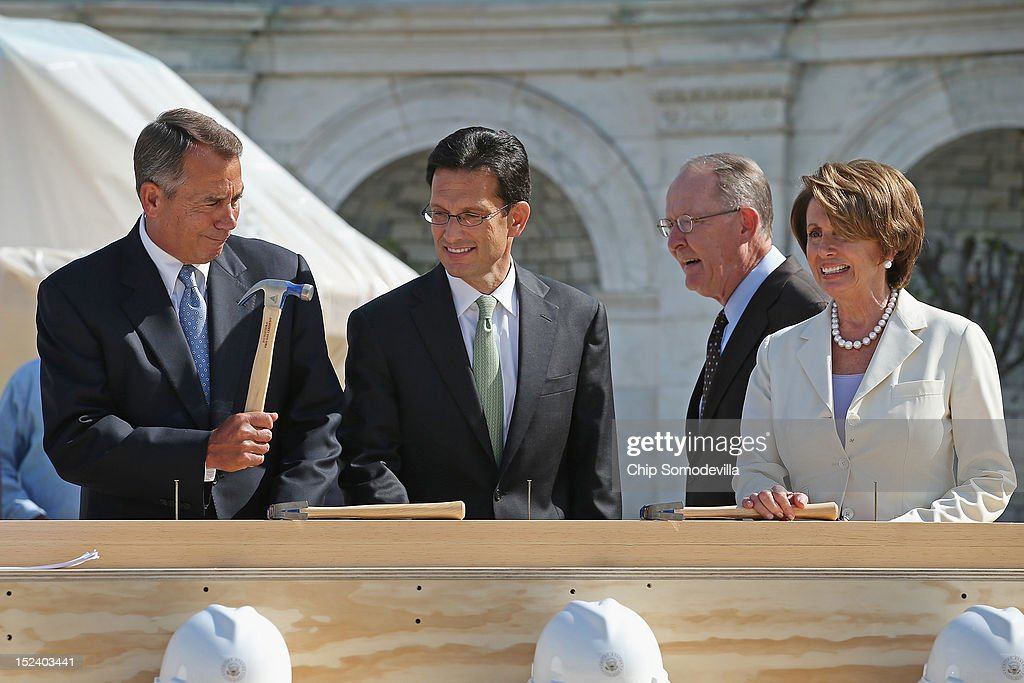 Speaker of the House John Boehner (R-OH) (L) jokingly wields his hammer with (L-R) House Majority Leader Eric Cantor (R-VA), Sen. Lamar Alexander (R-TN) and House Minority Leader Nancy Pelosi (D-CA) before the 'First Nail' ceremony, signifying the start of construction of the 2013 Inaugural Platform on the West Front of the U.S. Capitol September 20, 2012 in Washington, DC. The winner of the November 6 presidential election will be sworn in on the platform on January 21, 2013.