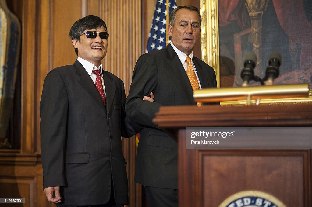 Speaker of the House John Boehner leads Chinese human rights activist Chen Guangcheng to speak to the press following a meeting at the US Capitol on...