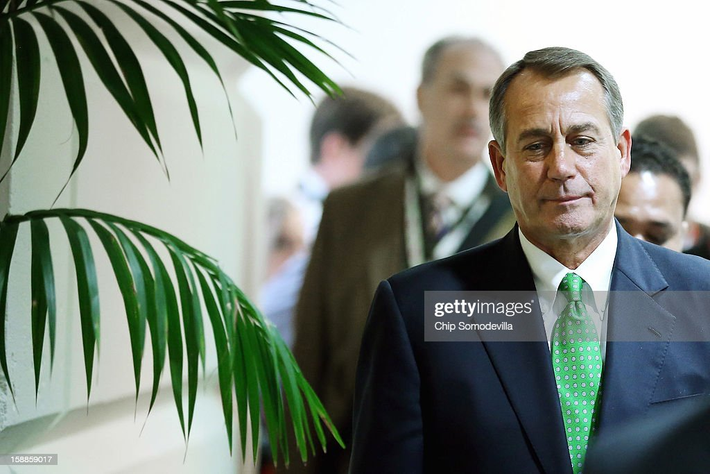 Speaker of the House <a gi-track='captionPersonalityLinkClicked' href=/galleries/search?phrase=John+Boehner&family=editorial&specificpeople=274752 ng-click='$event.stopPropagation()'>John Boehner</a> (R-OH) leaves a House Republican Caucus meeting where members considered the legislation that is supposed to blunt the effects of the 'fiscal cliff' during a rare New Year's Day session January 1, 2013 in Washington, DC. Vice President Joe Biden and Senate Minority Leader Mitch McConnell (R-KY) negotiated the deal that produced The American Taxpayer Relief Act of 2012, which passed the Senate after midnight on New Year's Day.
