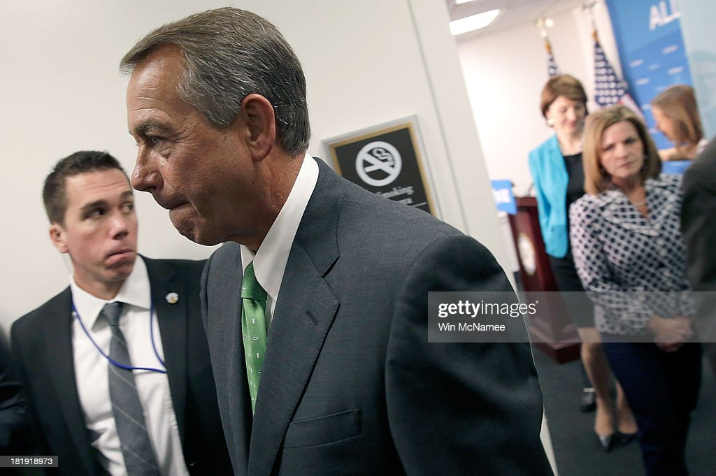 U.S. Speaker of the House <a gi-track='captionPersonalityLinkClicked' href=/galleries/search?phrase=John+Boehner&family=editorial&specificpeople=274752 ng-click='$event.stopPropagation()'>John Boehner</a> leaves a press conference at the U.S. Capitol September 26, 2013 in Washington, DC. Boehner signaled that he is urging Republican colleagues to remain flexible in negotiations to avert a governmental shutdown when federal funding runs out next week.