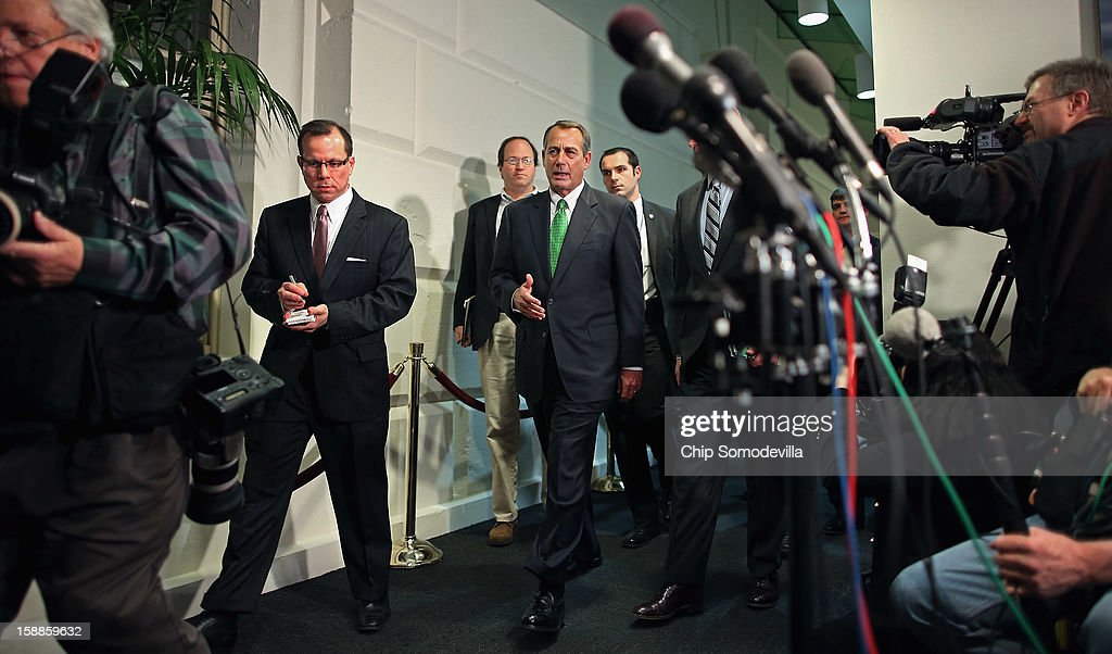 Speaker of the House <a gi-track='captionPersonalityLinkClicked' href=/galleries/search?phrase=John+Boehner&family=editorial&specificpeople=274752 ng-click='$event.stopPropagation()'>John Boehner</a> (R-OH) (C) leaves the second House Republican Caucus meeting of the day during a rare New Year's Day session January 1, 2013 in Washington, DC. The House is considering a negotiated bill to avert the 'fiscal cliff' that passed the Senate in the early hours Tuesday.
