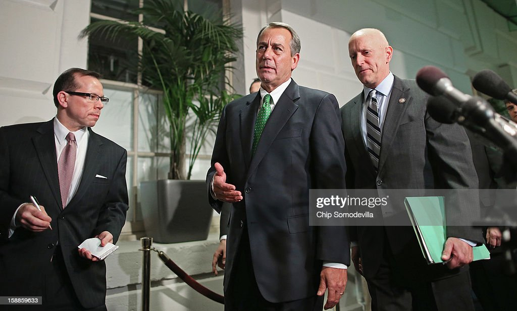 Speaker of the House <a gi-track='captionPersonalityLinkClicked' href=/galleries/search?phrase=John+Boehner&family=editorial&specificpeople=274752 ng-click='$event.stopPropagation()'>John Boehner</a> (R-OH) (C) leaves the second House Republican Caucus meeting of the day with House Ways and Means Committee Chairman Dave Camp (R-MI) (R) during a rare New Year's Day session January 1, 2013 in Washington, DC. The House is considering a negotiated bill to avert the 'fiscal cliff' that passed the Senate in the early hours Tuesday.