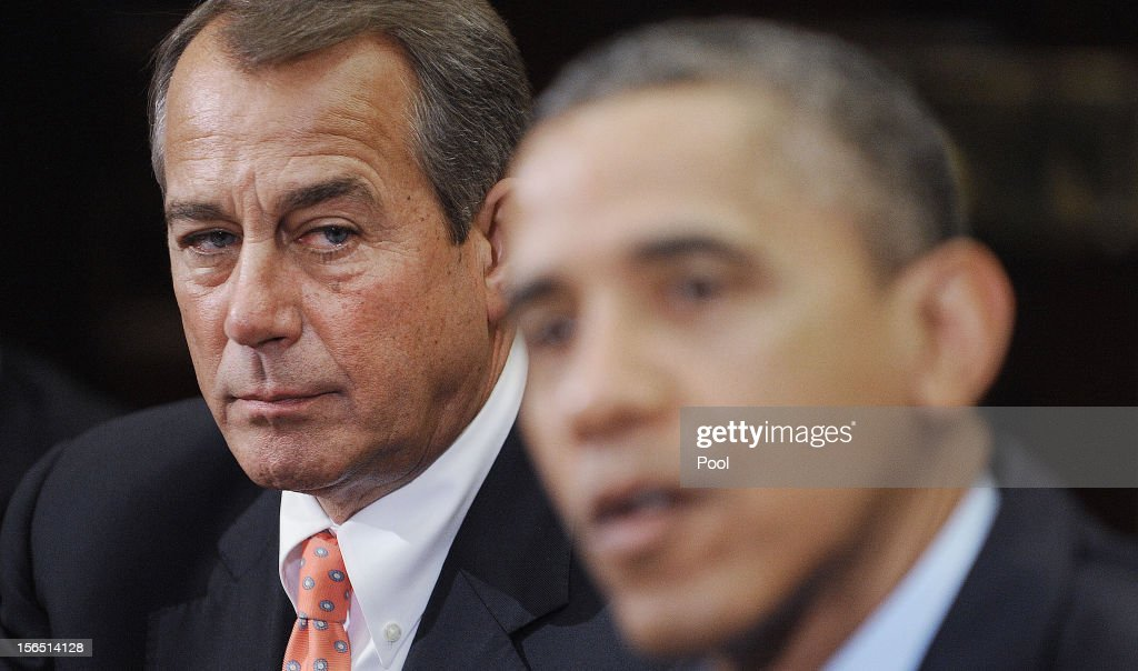 Speaker of the House <a gi-track='captionPersonalityLinkClicked' href=/galleries/search?phrase=John+Boehner&family=editorial&specificpeople=274752 ng-click='$event.stopPropagation()'>John Boehner</a> (R-OH) (L) listens as U.S. President <a gi-track='captionPersonalityLinkClicked' href=/galleries/search?phrase=Barack+Obama&family=editorial&specificpeople=203260 ng-click='$event.stopPropagation()'>Barack Obama</a> speaks during a meeting with bipartisan group of congressional leaders in the Roosevelt Room of the White House on November 16, 2012 in Washington, DC. Obama and congressional leaders of both parties are meeting to reportedly discuss deficit reduction before the tax increases and automatic spending cuts go into affect in the new year.
