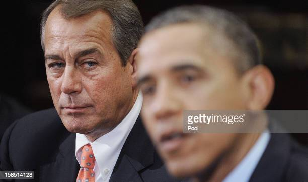 Speaker of the House John Boehner listens as US President Barack Obama speaks during a meeting with bipartisan group of congressional leaders in the...