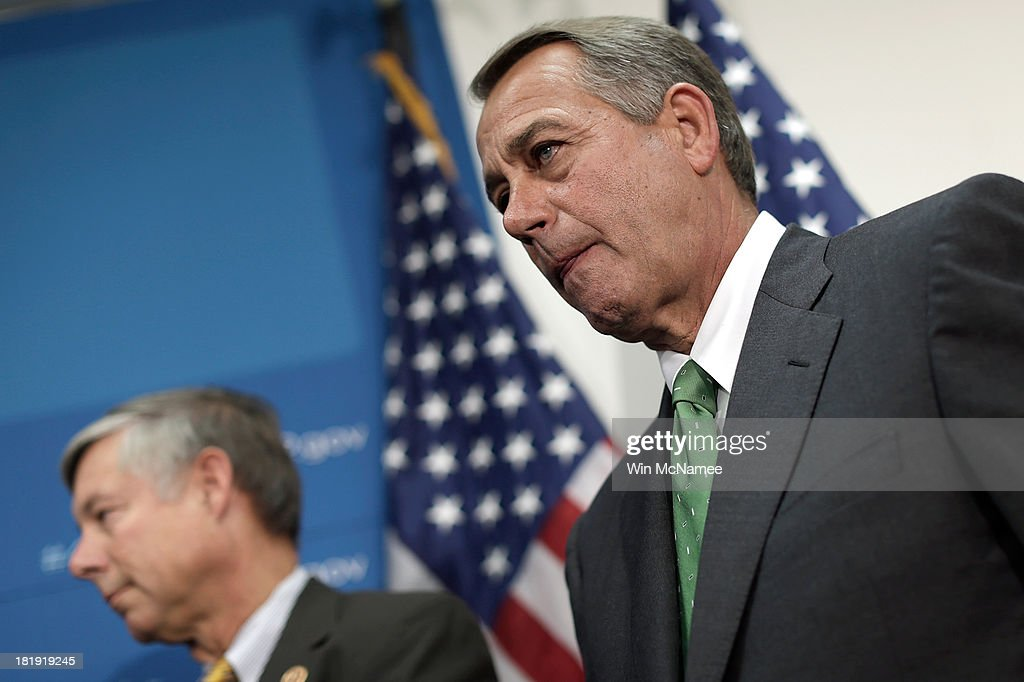 U.S. Speaker of the House <a gi-track='captionPersonalityLinkClicked' href=/galleries/search?phrase=John+Boehner&family=editorial&specificpeople=274752 ng-click='$event.stopPropagation()'>John Boehner</a> (R) (R-OH) listens to House Republican colleagues speak at a press conference at the U.S. Capitol September 26, 2013 in Washington, DC. Boehner signaled that he is urging Republican colleagues to remain flexible in negotiations to avert a governmental shutdown when federal funding runs out next week. Also pictured is Rep. Fred Upton (L) (R-MI).