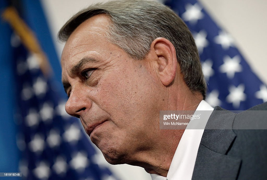 U.S. Speaker of the House <a gi-track='captionPersonalityLinkClicked' href=/galleries/search?phrase=John+Boehner&family=editorial&specificpeople=274752 ng-click='$event.stopPropagation()'>John Boehner</a> listens to House Republican colleagues speak at a press conference at the U.S. Capitol September 26, 2013 in Washington, DC. Boehner signaled that he is urging Republican colleagues to remain flexible in negotiations to avert a governmental shutdown when federal funding runs out next week.