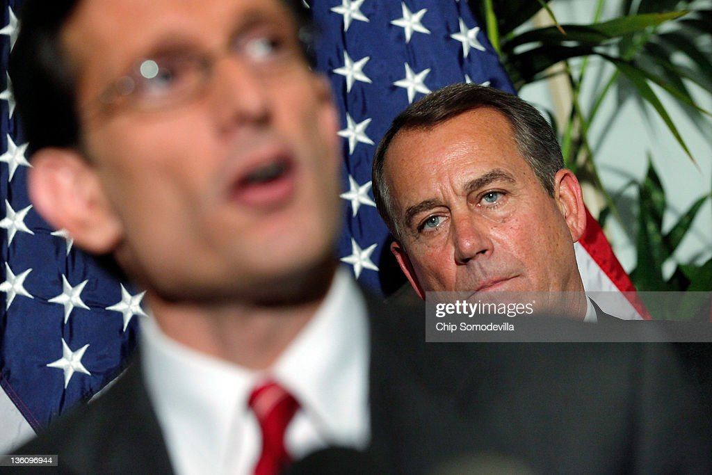 Speaker of the House John Boehner (R-OH) (R) listens to Majority Leader <a gi-track='captionPersonalityLinkClicked' href=/galleries/search?phrase=Eric+Cantor&family=editorial&specificpeople=653711 ng-click='$event.stopPropagation()'>Eric Cantor</a> (R-VA) make remarks during a brief news conference after a House GOP caucus meeting at the U.S. Capitol December 19, 2011 in Washington, DC. Boehner said he expects the House to reject a short-term plan to extend the tax cuts for another two months that passe the Senate last week.
