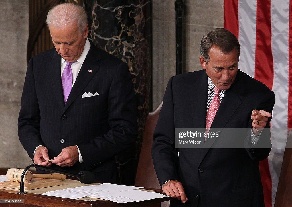 Speaker of the House <a gi-track='captionPersonalityLinkClicked' href=/galleries/search?phrase=John+Boehner&family=editorial&specificpeople=274752 ng-click='$event.stopPropagation()'>John Boehner</a> (R) (R-OH) points to a colleague as he waits with U.S. Vice President Joe Biden (L) prior to the start of a Joint Session of Congress where U.S. President Barack Obama is scheduled to speak at the U.S. Capitol September 8, 2011 in Washington, DC. Obama will address both houses of the U.S. legislature to highlight his plan to create jobs for millions of out of work Americans.