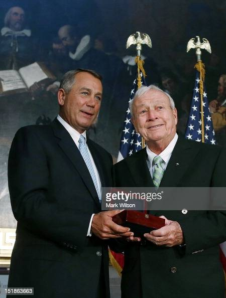 Speaker of the House John Boehner presents golfing legend Arnold Palmer with the Congressional Gold Medal during a ceremony at the US Capitol on...