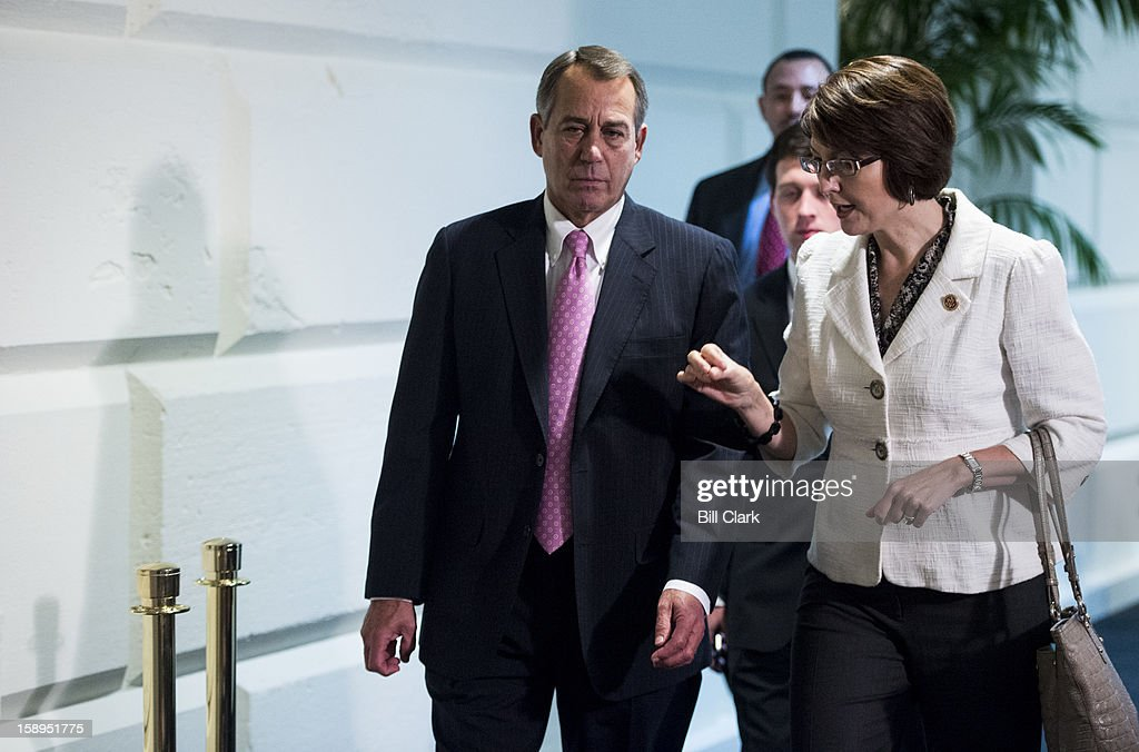 Speaker of the House John Boehner, R-Ohio, and Republican Conference Chairman Cathy McMorris Rodgers, R-Wash., talk as they leave the House Republican Conference meeting on Friday, Jan. 4, 2013.