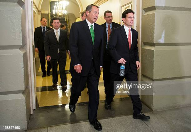 Speaker of the House John Boehner ROhio center and House Majority Leader Eric Cantor RVa right arrive for the House Republican Conference meeting on...
