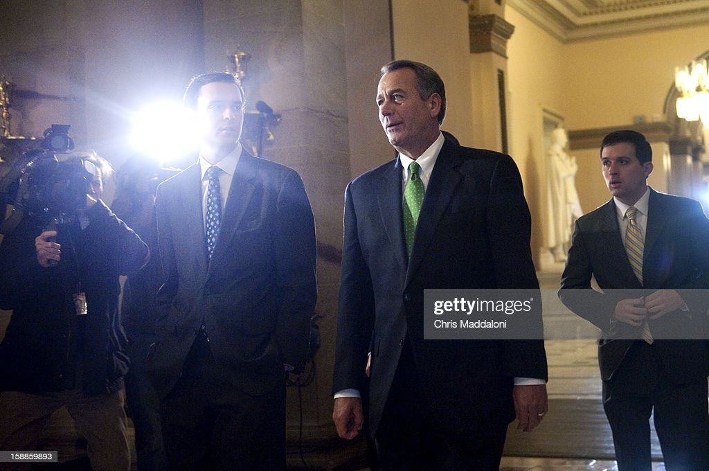 Speaker of the House John Boehner, R-Ohio, leaves the House floor at the U.S. Capitol as his party was trying to whip up enough votes to add an amendment to cut spending to Senate's solution for the 'Fiscal Cliff.'