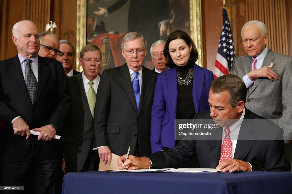 Speaker of the House John Boehner (R-OH) signs the Clay Hunt Suicide Prevention for American Veterans Act with (L-R) Sen. <a gi-track='captionPersonalityLinkClicked' href=/galleries/search?phrase=John+McCain&family=editorial&specificpeople=125177 ng-click='$event.stopPropagation()'>John McCain</a> (R-AZ), Rep. Timothy Walz (D-MN), House Veterans Affairs Committee Chairman Jeff Miller (R-FL), Senate Armed Services Committee Chairman <a gi-track='captionPersonalityLinkClicked' href=/galleries/search?phrase=Johnny+Isakson&family=editorial&specificpeople=534354 ng-click='$event.stopPropagation()'>Johnny Isakson</a> (R-GA), Senate Majority Leader <a gi-track='captionPersonalityLinkClicked' href=/galleries/search?phrase=Mitch+McConnell&family=editorial&specificpeople=217985 ng-click='$event.stopPropagation()'>Mitch McConnell</a> (R-KY), House Minority Whip <a gi-track='captionPersonalityLinkClicked' href=/galleries/search?phrase=Steny+Hoyer&family=editorial&specificpeople=588093 ng-click='$event.stopPropagation()'>Steny Hoyer</a> (D-MD), Clay Hunt's mother Susan Selke and Sen. Orrin Hatch (R-UT) in the Rayburn Room at the U.S. Capitol February 10, 2015 in Washington, DC. A decorated combat veteran of Iraq and Afghanistan, Clay Hunt became a prominent advocate for troops suffering from post-traumatic stress disorder after leaving the Marine Corps and later killed himself in 2011.