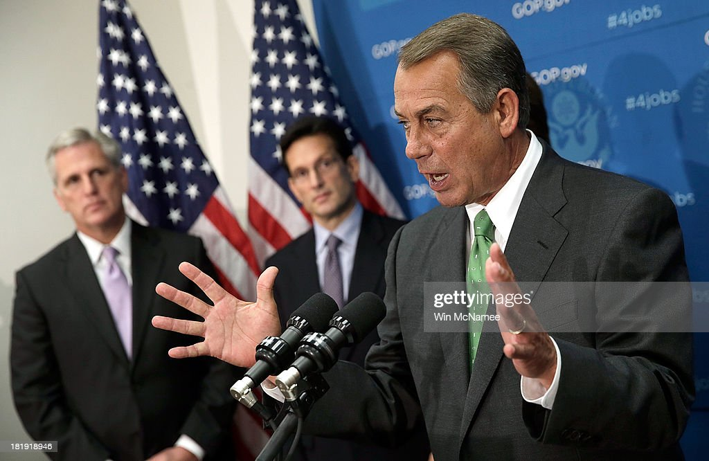 U.S. Speaker of the House <a gi-track='captionPersonalityLinkClicked' href=/galleries/search?phrase=John+Boehner&family=editorial&specificpeople=274752 ng-click='$event.stopPropagation()'>John Boehner</a> speaks at a press conference at the U.S. Capitol September 26, 2013 in Washington, DC. Boehner signaled that he is urging Republican colleagues to remain flexible in negotiations to avert a governmental shutdown when federal funding runs out next week. Also pictured are (L-R) House Majority Whip Kevin McCarthy (R-CA) and House Majority Leader Eric Cantor (R-VA).