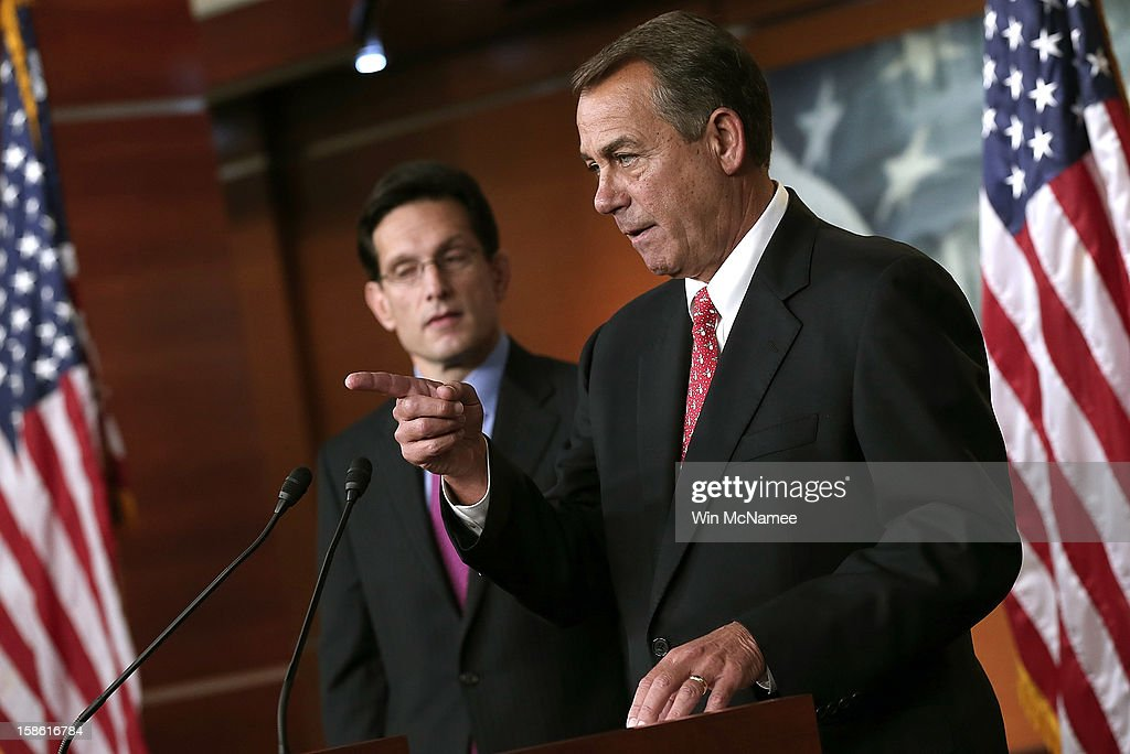 Speaker of the House John Boehner speaks during a press conference with House Majority Leader Eric Cantor at the US Capitol December 21 2012 in...
