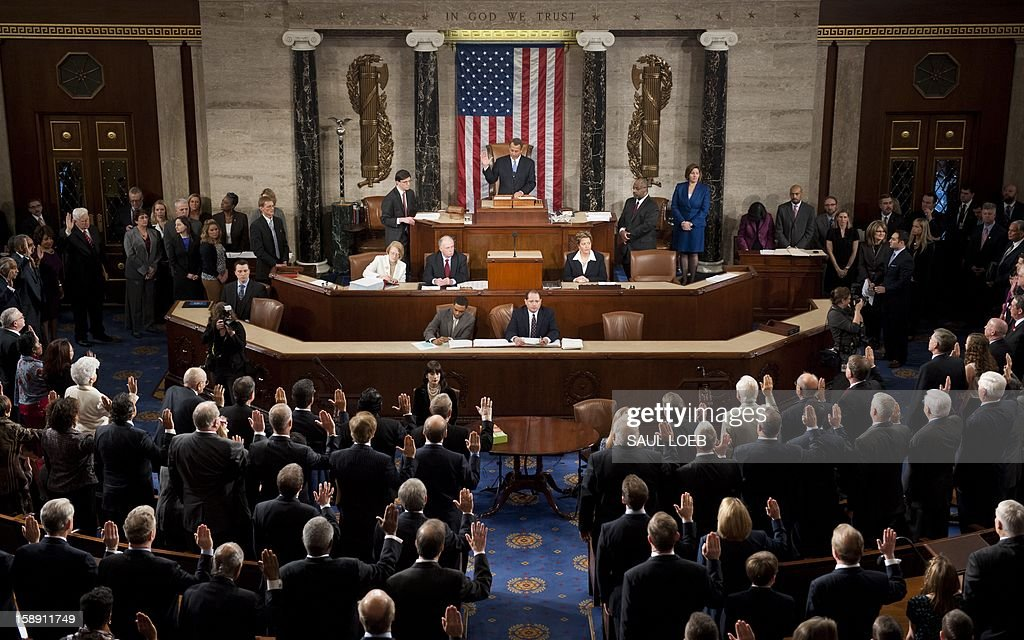 Speaker of the House John Boehner swears in members of the 113th US House of Representatives during the opening session at the US Capitol in Washington, DC, on January 3, 2013. AFP PHOTO / Saul LOEB