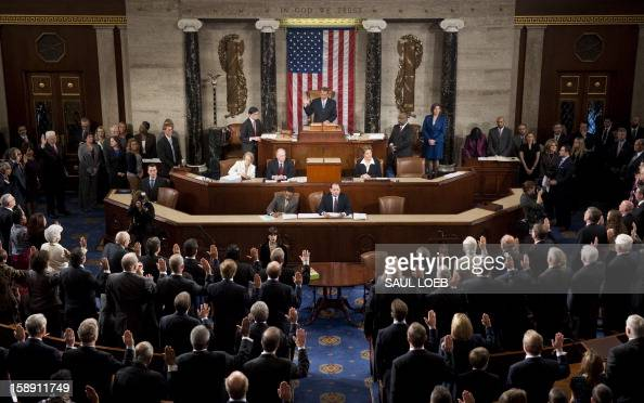 Speaker of the House John Boehner swears in members of the 113th US House of Representatives during the opening session at the US Capitol in...