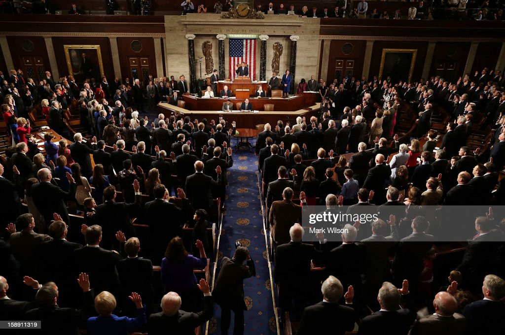 Speaker of the House <a gi-track='captionPersonalityLinkClicked' href=/galleries/search?phrase=John+Boehner&family=editorial&specificpeople=274752 ng-click='$event.stopPropagation()'>John Boehner</a> (R-OH) swears in the newly elected members of the first session of the 113th Congress in the House Chambers January 3, 2013 in Washington, DC. House Speaker Boehner was re-elected as Speaker and presided over the swearing in of the newly elected members of the 113th Congress.