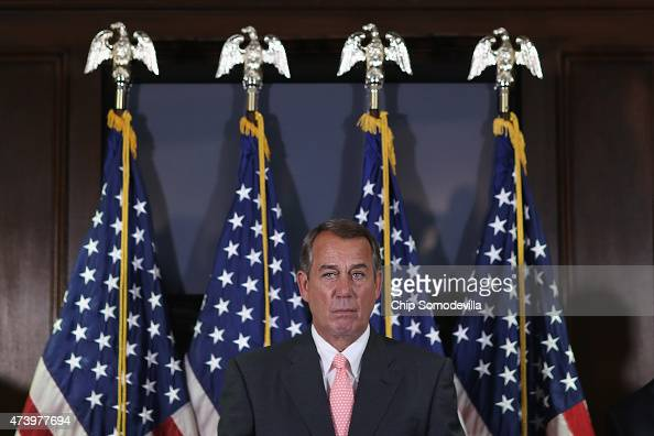 Speaker of the House John Boehner talks to reporters after the weekly House GOP caucus meeting at the Republican National Committee headquarters on...