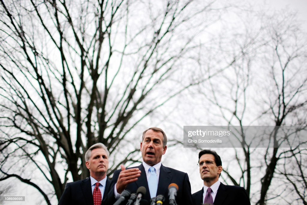 Speaker of the House John Boehner talks to reporters with House Majority Whip Kevin McCarthy and Majority Leader Eric Cantor after a lunch meeting at...