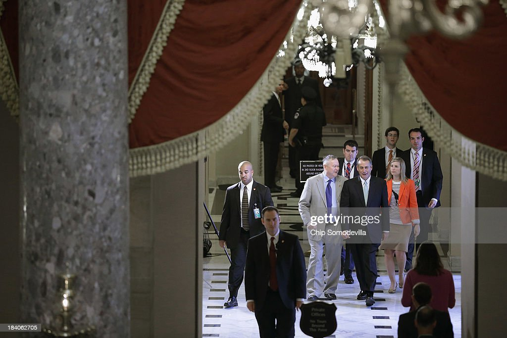 Speaker of the House <a gi-track='captionPersonalityLinkClicked' href=/galleries/search?phrase=John+Boehner&family=editorial&specificpeople=274752 ng-click='$event.stopPropagation()'>John Boehner</a> (R-OH) talks with Rep. <a gi-track='captionPersonalityLinkClicked' href=/galleries/search?phrase=Dana+Rohrabacher&family=editorial&specificpeople=2337249 ng-click='$event.stopPropagation()'>Dana Rohrabacher</a> (R-CA) after leaving the floor of the House of Representatives during the 11th day of the federal government partial shutdown at the U.S. Capitol October 11, 2013 in Washington, DC. On Thursday Boehner and the House Republicans offered to raise the federal debt limit for six week to begin budget negotiations with the Senate Democrats and the White House. Democrats say the deal is a starting point for negotiations but have not embraced the offer because it doesn't end the partial shutdown of the federal government but.